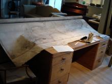 Repairs to a large early 19th century map of Britain.