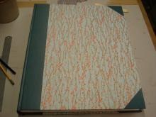 Large case binding, cloth spine and corners, Japanese paper sides.