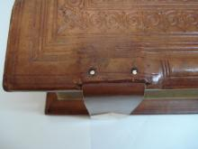 Detail of new strap attached to board to wooden board.