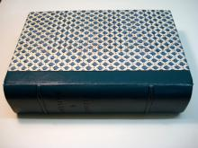 Quarter leather binding, decorative paper sides.