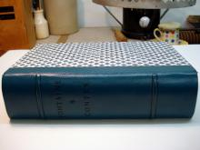 Quarter leather binding, decorative paper sides, two raised bands.