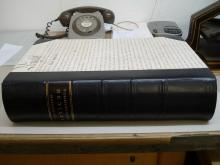 Large half leather binding, calf with morocco label, vellum manuscript deed on sides.